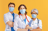 Team of doctors wearing facemasks