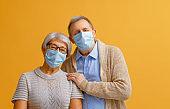Senior couple wearing facemask