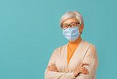 Senior woman wearing facemask