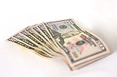 A fan of dollar money notes.
