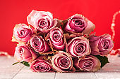 Valentine's day background. Bouquet of roses on a red background. Concept February 14, March 8