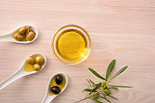 Assortment of olives and oil in bowl on bench top
