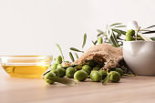 Olive oil essence for body and culinary care front view