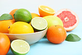 Different citrus fruits on the table. Juicy citrus fruits.