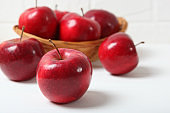 ripe juicy red apples on the table.