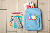 school backpack and school stationery top view. Concept back to school.