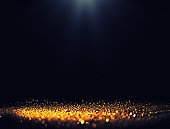 Black background with spotlight to Luxurious gold glitter sparkling background