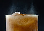 ice cube in fizzy splashing water with soda bubble, coca-cola