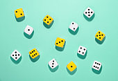 Randomly scattered yellow and white dice