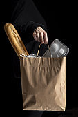 Unrecognizable woman with take away food bags