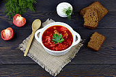 Traditional ukrainian and russian beetroot  soup  or borscht with greens and sour cream  in bowl