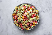 Homemade popcorn on on colorful backgrounds