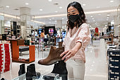 Indonesian woman shopping shoes in department store