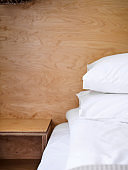 fresh white clean bedding on a wooden bed