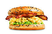 Fried bacon avocado cheese egg salad  bagel on a white isolated background
