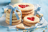 Milky valentine cookies with red strawberries jam