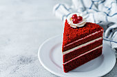 Red velvet cake with cream cheese filling in a plate