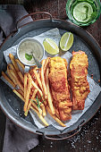 Homemade fries and cod served with lime and salt