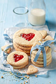 Delicious valentine cookies with red strawberries jam