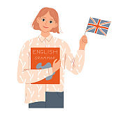 Girl student holds a book and an English flag.She is a native speaker or learns English.