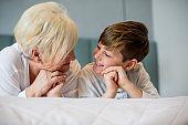 Grandmother embracing her cute grandson