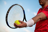 Close up image of racket and tennis ball