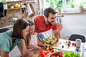 Family having fun in kitchen