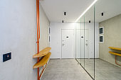 Interior of new empty apartment, long home corridor with marble floor