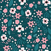 Seamless pattern with different doodle flowers and leaves.