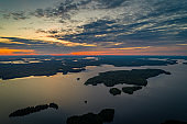 Suoyarvi lake at sunset surrounded by forests of Karelia