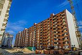 construction building industry area brick exterior facade shape and high crane