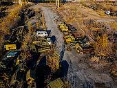 Old rusty broken Russian military cars for scrap metal, aerial view