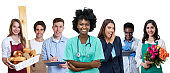 Laughing african american female nurse with group of aprentices