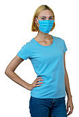 Beautiful woman with blond hair and homemade face mask as protection against covid-19 infection