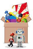 Cardboard box full of toys on white background