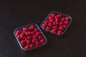 Fresh raspberries in plastic container