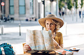 Senior woman on a journey enjoying her coffee and planning sightseeing