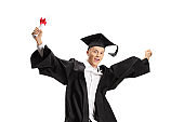 Happy male graduate student with a diploma jumping