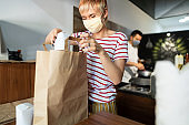 Fast food restaurant delivering food with extra coronavirus precautions