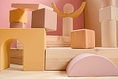 A town made of elements of a wooden children's designer of pastel colors.