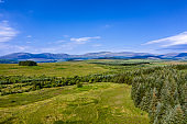 High angle view of rural Dumfries and Galloway with pine forest and hills