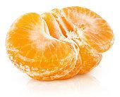 half of tangerine or orange citrus fruit isolated on white