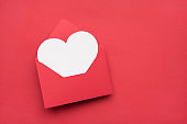 Happy Valentines day concept. Top above overhead close up view photo image of open envelope and white greeting card inside with copy space isolated bright color texture table