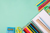 Back to school concept. Top above overhead view photo of colorful school stationery isolated on turquoise background with copyspace