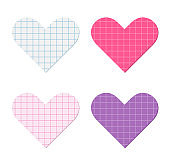 Heart shapes cut out of squared graph paper