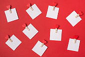I love you messages concept. Top above close up view photo of pile many pins with empty paper for text isolated red bright color background