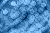 Abstract blurred blue background with beautiful bokeh effect.