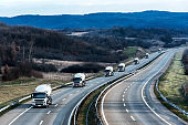 Fleet of White Tank truck or cistern on a Highway Road