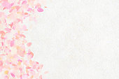 Japanese style background of Japanese paper and pink cherry blossom petals