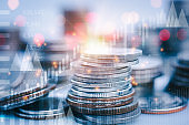 rows of coins for financial stock market graph and rows of coins growth , money , investment and business concept,business investment and currency exchange background